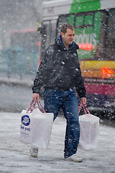 © under license to London News Pictures.  17/12/2010 A shopper braves the snow and cold weather in Plymouth this morning (17/12/2010). Snow is forcast for much of the South West over the next few days. Picture credit should read: David Hedges/LNP