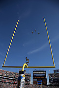 Three F-18 Hornet jets fly over Qualcomm Stadium in this wide angle, general view photo of the stadium and end zone goal post taken from field level during pregame before the San Diego Chargers NFL week 15 regular season football game against the Denver Broncos on Sunday, Dec. 14, 2014 in San Diego. The Broncos won the game 22-10. ©Paul Anthony Spinelli
