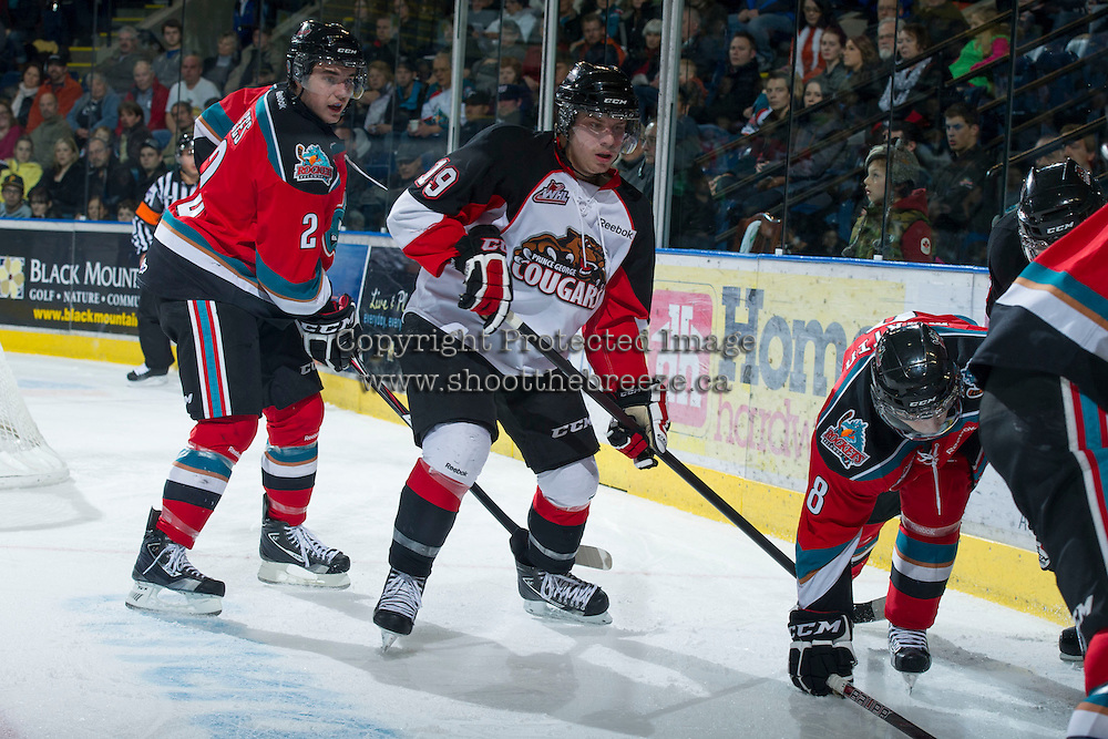 KELOWNA, CANADA - DECEMBER 8:  Jesse Lees #2 of the Kelowna Rockets and Jordon Tkatch #19 of the Prince George Cougars look for the puck at the Kelowna Rockets on December 8, 2012 at Prospera Place in Kelowna, British Columbia, Canada (Photo by Marissa Baecker/Shoot the Breeze) *** Local Caption ***