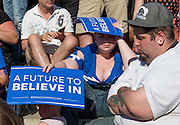 Bernie Sanders supporters shade themselves from the sun while waiting for Democratic Presidential Candidate Sen. Bernie Sanders to participate in a A Future to Believe In rally on June 9, 2016, in Washington, DC.
