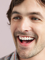 Mid adult man laughing close-up