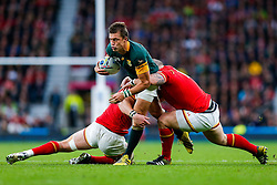 South Africa Fly-Half Handre Pollard is tackled by Wales Flanker Dan Lydiate and replacement Paul James - Mandatory byline: Rogan Thomson/JMP - 07966 386802 - 17/10/2015 - RUGBY UNION - Twickenham Stadium - London, England - South Africa v Wales - Rugby World Cup 2015 Quarter Finals.
