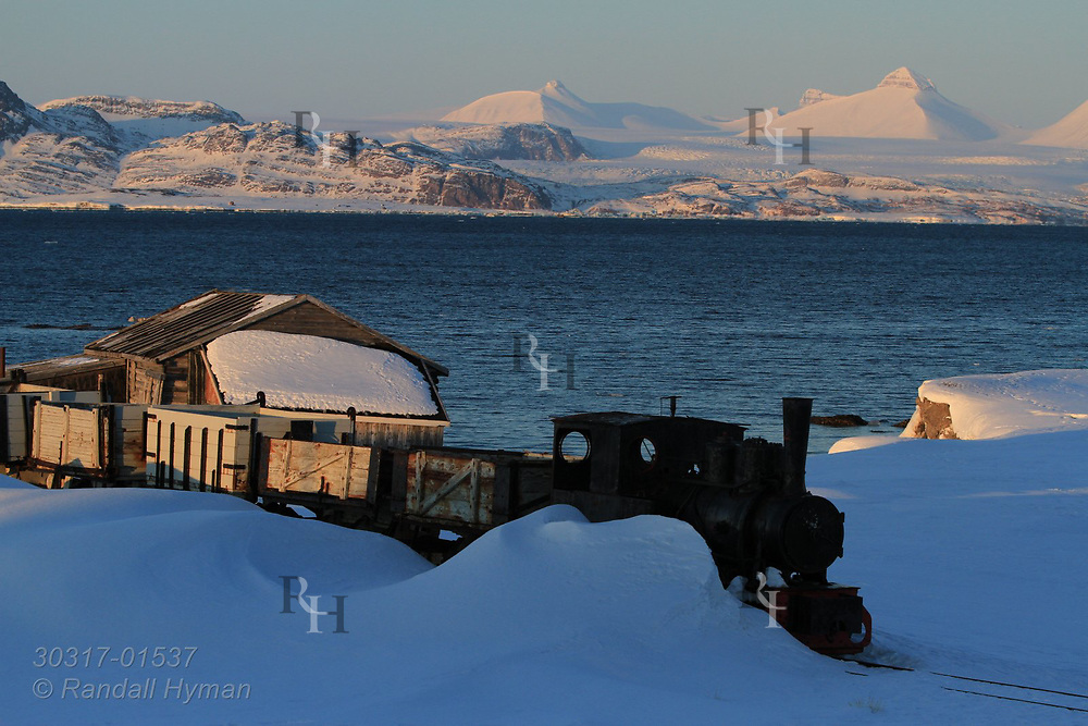 Steam train that once carried coal from mines to harbor sits on outskirts of the international science village of Ny-Alesund on Spitsbergen island in Kongsfjorden; Svalbard, Norway.