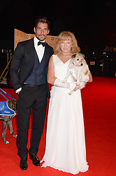 DAVID GANDY and CLAIRE HORTON Chief Executive of Battersea Dogs & Cats Home with her dog Wilma at the Collars & Coats Gala Ball in aid of Battersea Dogs & Cats Home held at Battersea Evolution, Battersea Park, London on 7th November 2013.