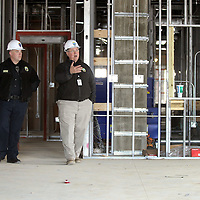 Adam Robison | BUY AT PHOTOS.DJOURNAL.COM<br /> Lee Miller, Sergeant with the Tupelo police Department, is given a tour of the new police station that is being built on Front Street by Tupelo Police Chief Bart Aguirre, Tuesday afternoon in Tupelo.