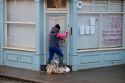 © Licensed to London News Pictures. 29/12/15<br /> York, UK. <br /> <br /> A man enters his business as flood water begins to subside on Huntington Road in York. Further rainfall is expected over coming days as Storm Frank approaches the east coast of the country.<br /> <br /> Photo credit : Ian Forsyth/LNP