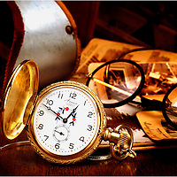 A pocket watch and glasses