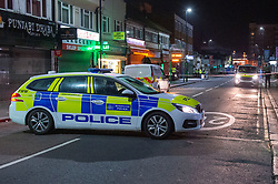 © Licensed to London News Pictures. 05/02/2020. London, UK. A police vehicle forms a cordon after the Metropolitan Police Service was called to Kingsley Rd in Hounslow at 19:23GMT on Tuesday 4th Feb to reports of a fight. A 19-year-old man then self-presented at a hospital with stab injuries. One person has been arrested. Photo credit: Peter Manning/LNP