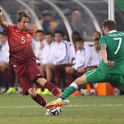 Fábio Coentrão, Portugal, is challenged by Aiden McGeady, Ireland, during the Portugal V Ireland International Friendly match in preparation for the 2014 FIFA World Cup in Brazil. MetLife Stadium, Rutherford, New Jersey, USA. 10th June 2014. Photo Tim Clayton
