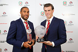 CARDIFF, WALES - Monday, October 6, 2014: Wales' Club Player of the Year captain Ashley Williams and Player of the Year 2014 Gareth Bale with their trophies at the FAW Footballer of the Year Awards 2014 held at the St. David's Hotel. (Pic by David Rawcliffe/Propaganda)