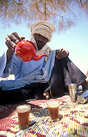 Taureg pouring mint tea in Algeria