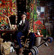 William Burroughs at home in Lawrence with shotgun paintings