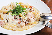 A serving of Penne pasta with Shrimps and cream sauce