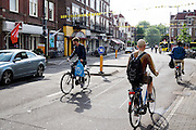 Nederland, Utrecht, 22-07-2015<br /> Fietsers in de Burgermeester Reigerstraat in Utrecht, een van de drukste straten met fietsers in Nederland.<br /> <br /> The Burgemeester Reigerstraat is one of the busiest streets with bicycles in The Netherlands.<br /> Foto: Bas de Meijer / Hollandse Hoogte
