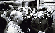 "General Nikita Khrushchev meets with officers in Ukraine during World War II. From wikipedia, ""In the months following the German invasion, in 1941, Khrushchev, as a local party leader, coordinated the defense of Ukraine but was dismissed and recalled to Moscow after surrendering Kiev."""