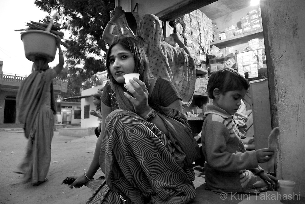 Preeti, 23, drinks a cup of tea as she waits for customers in Tilawada, a red light district, 30 km west of Jaipur. Preeti, who is from Ingonia, has been in the business over five years. ..