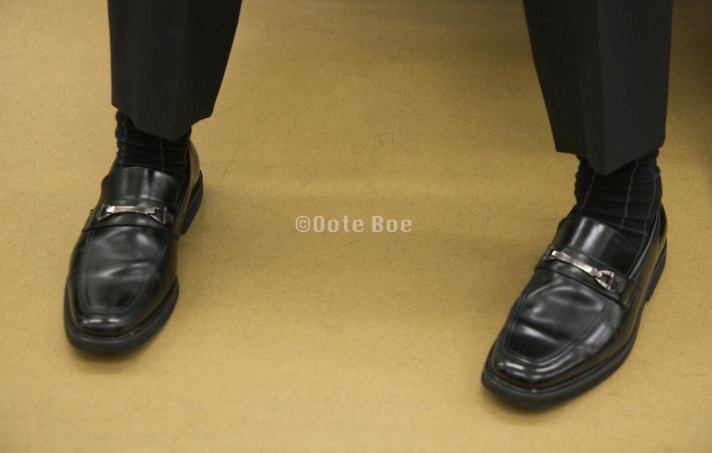 close up of a businessman's shiny shoes