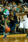 WACO, TX - JANUARY 28: Juwan Staten #3 of the West Virginia Mountaineers drives to the basket against the Baylor Bears on January 28, 2014 at the Ferrell Center in Waco, Texas.  (Photo by Cooper Neill/Getty Images) *** Local Caption *** Juwan Staten