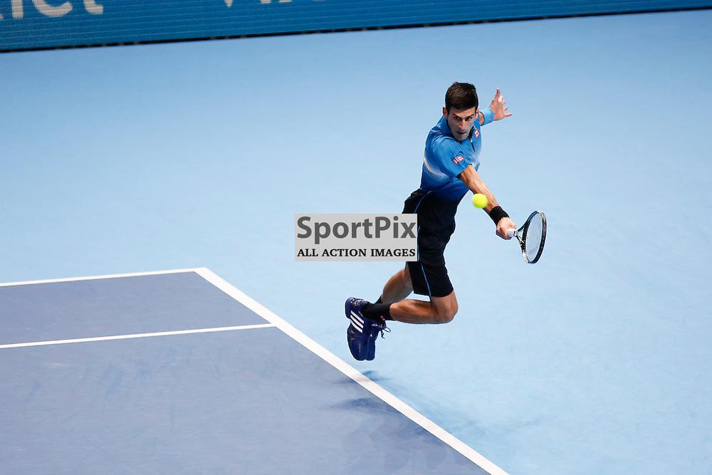 Novak Djokovic's hits a backhand in the ATP World Tour Final match between Novak Djokovic and Roger Federer at the O2 Arena, London 2015.  on November 22, 2015 in London, England. (Credit: SAM TODD | SportPix.org.uk)