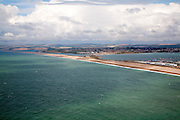 Chesil Beach with Weymouth harbour beyond, Isle of Portland, Dorset, England, UK