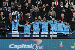 Manchester City celebrate winning the Capital One Cup - Photo mandatory by-line: Dougie Allward/JMP - Tel: Mobile: 07966 386802 02/03/2014 - SPORT - FOOTBALL - London - Wembley Stadium - Manchester City v Sunderland - Capital One Cup Final