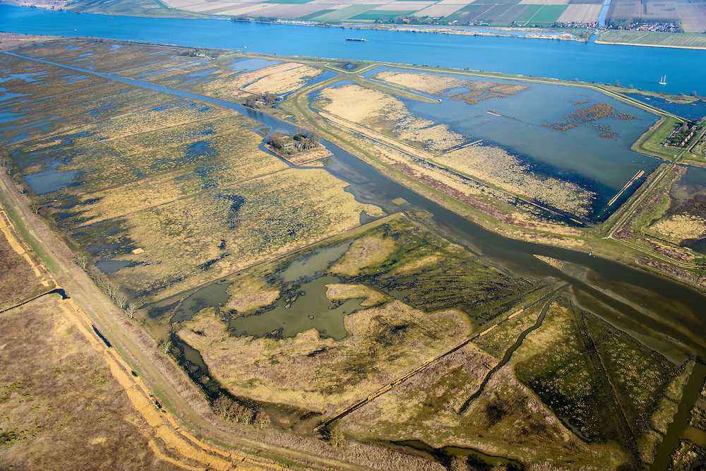 Nederland, Zuid-Holland, Tiengemeten, 01-04-2016;  Het eiland Tiengemeten (abusieveelijke ook  Tiengemeenten) werd oorspronkelijk gebruikt voor de akkerbouw maar is inmiddels 'teruggegeven aan de natuur': de dijken zijn deels doorgestoken en de laatste boer is in 2006 vertrokken. De 'nieuwe natuur' vormt onderdeel van de Ecologische Hoofdstructuur.<br /> The island Tiengemeten in the Haringvliet, was originally used for agriculture but has now &quot;been given back to nature&quot;. Large parts have been flooded and the isle is part of the National Ecological Network. The last farmer left in 2006. Current use, among other, care farms and camping. luchtfoto (toeslag op standard tarieven);<br /> aerial photo (additional fee required);<br /> copyright foto/photo Siebe Swart