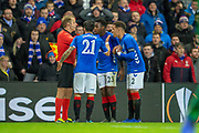 Daniel Candeias (#21) of Rangers FC, Lassana Coulibaly (#23) of Rangers FC and James Tavernier (#2) of Rangers FC argue with the assistant referee after Candeias is shown a red card during the Europa League group stage match between Rangers FC and Villareal CF at Ibrox, Glasgow, Scotland on 29 November 2018.