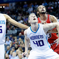 03 November 2015: Charlotte Hornets forward Cody Zeller (40) vies for the rebound Chicago Bulls center Joakim Noah (13) next to Charlotte Hornets forward Nicolas Batum (5) during the Charlotte Hornets  130-105 victory over the Chicago Bulls, at the Time Warner Cable Arena, in Charlotte, North Carolina, USA.