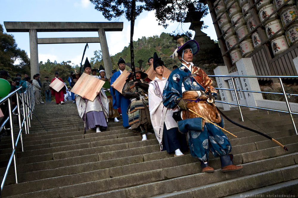 The first three yabusame archers are the ones who will devote their three first shots to the gods of Tado shrine, are walking towards the Yabusame track.