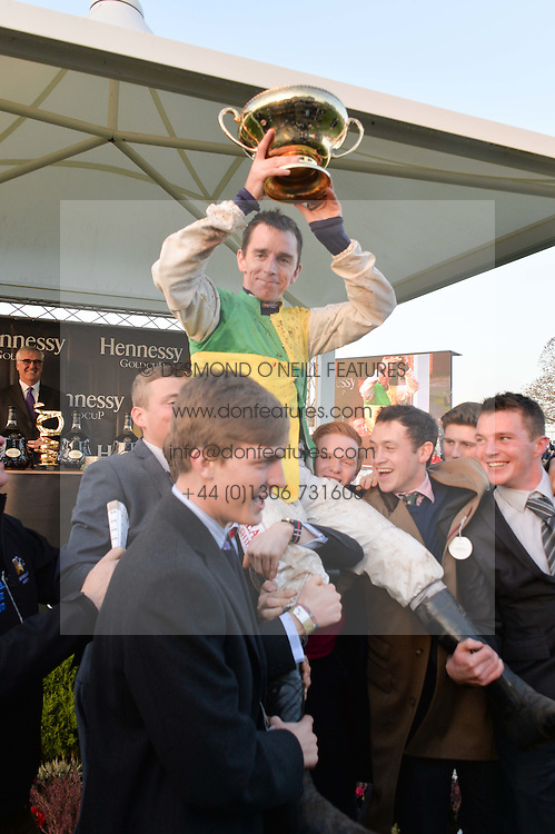 LEIGHTON ASPELL rider of Many Clouds winner of the 2014 Hennessy Gold Cup at the 2014 Hennessy Gold Cup at Newbury Racecourse, Newbury, Berkshire on 29th November 2014.  The Gold Cup was won by Many Clouds ridden by Leighton Aspell.