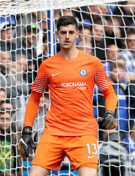"""Chelsea goalkeeper Thibaut Courtois during the Premier League match at Stamford Bridge, London. PRESS ASSOCIATION Photo. Picture date: Sunday September 17, 2017. See PA story SOCCER Chelsea. Photo credit should read: Jonathan Brady/PA Wire. RESTRICTIONS: EDITORIAL USE ONLY No use with unauthorised audio, video, data, fixture lists, club/league logos or """"live"""" services. Online in-match use limited to 75 images, no video emulation. No use in betting, games or single club/league/player publications."""