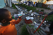 A South African boy drinks a soft drink next to a severely polluted river in Masiphumelele, Cape Town, South Africa 12 March 2010. The polluted and congested river runs through the residential area and the communal water collection point which poses serious health risks. Some analysts predict that by 2025 more than 1.8 billion people will  live in areas where uncontaminated water is in short supply. World Water Day is marked on 22 March 2010.  The official United Nations statement reads: ?The theme of this year?s World Water Day, ?Clean Water for a Healthy World?, emphasizes that both the quality and the quantity of water resources are at risk. More people die from unsafe water than from all forms of violence, including war. These deaths are an affront to our common humanity, and undermine the efforts of many countries to achieve their development potential.?  World Water Day has been held to celebrate freshwater annually since 1993.