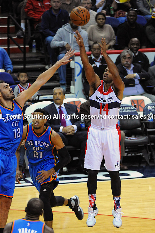 10 November 2015:  Washington Wizards guard Gary Neal (14) in action against Oklahoma City Thunder center Steven Adams (12) at the Verizon Center in Washington, D.C. where the Oklahoma City Thunder defeated the Washington Wizards, 125-101. (Photograph by Icon Sportswire)
