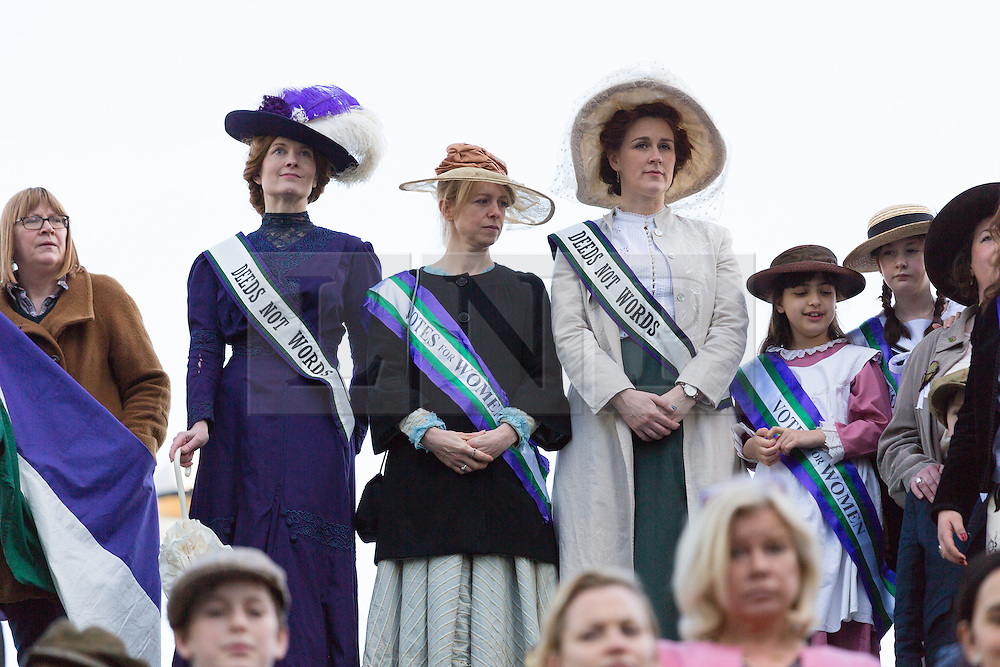 "© Licensed to London News Pictures. 08/03/2015. London, UK. People dressed as suffragettes at the ""Walk In Her Shoes"" event to mark International Women's Day at The Scoop amphitheatre on the south bank in London. Photo credit : Vickie Flores/LNP"
