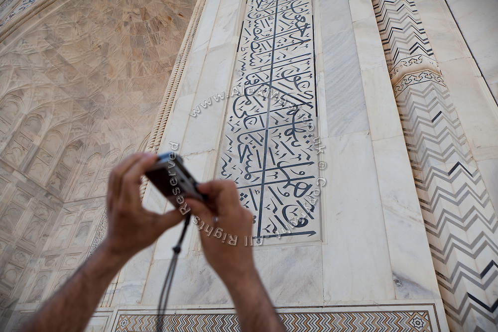 A visitors taking a picture of the Taj Mahal, in Agra.