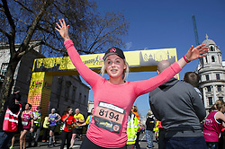 Competitor Aimee Fuller crosses the finish linne during the 2019 London Landmarks Half Marathon.