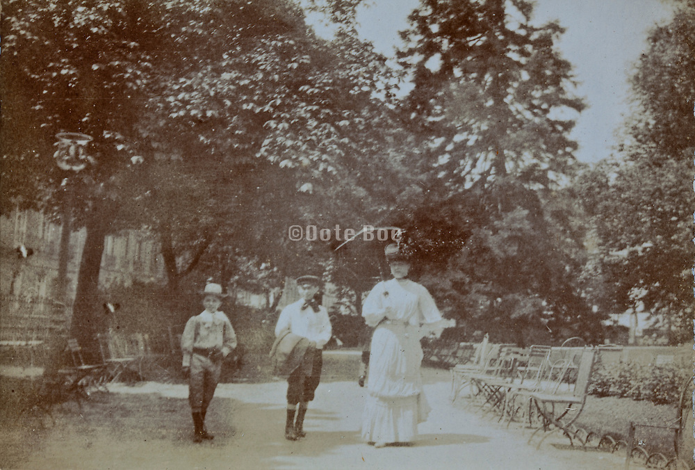 mother with children walking in a park early 1900s France