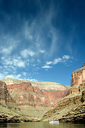 Virga (rain that evaporates before hitting the ground) falls over the Colorado River and rafters, Grand Canyon National Park, Arizona, US