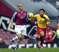 Photo: Olly Greenwood.<br />West Ham United v Watford. The Barclays Premiership. 10/02/2007. West Ham's Nigel Quashie and Watford's Johan Cavalli