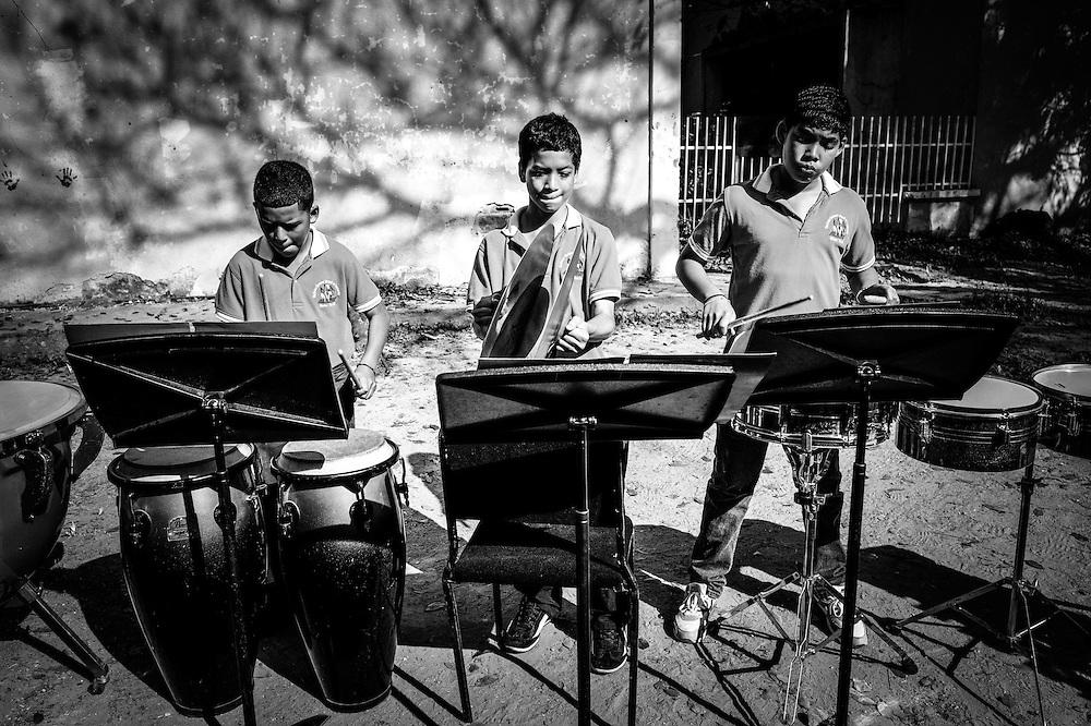 Children learn to play classical music at the Sarria nucleo, of the El Sistema music program in a dangerous slum in Caracas, Venezuela.