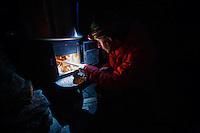 Wood burning stove at Icefall Lodge, British Columbia.