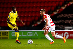 James Coppinger of Doncaster Rovers takes on Abu Ogogo of Bristol Rovers - Mandatory by-line: Robbie Stephenson/JMP - 26/03/2019 - FOOTBALL - Keepmoat Stadium - Doncaster, England - Doncaster Rovers v Bristol Rovers - Sky Bet League One