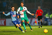 Plymouth Argyle defender Gary Sawyer (3) battles with Wycombe Wanderers midfielder Dominic Gape(4) during the EFL Sky Bet League 1 match between Wycombe Wanderers and Plymouth Argyle at Adams Park, High Wycombe, England on 26 January 2019.