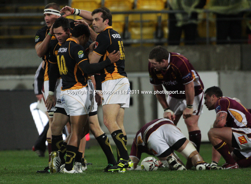 Wellington players congratulate Apoua Stewart on his try. ITM Cup rugby union - Wellington Lions v Southland Stags at Westpac Stadium, Wellington, New Zealand on Thursday, 18 August 2011. Photo: Dave Lintott / photosport.co.nz
