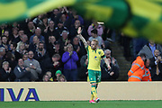 Norwich City forward Alex Pritchard (21) celebrates as Brighton & Hove Albion goalkeeper David Stockdale (13) is credited for an own goal to make it 2-0 during the EFL Sky Bet Championship match between Norwich City and Brighton and Hove Albion at Carrow Road, Norwich, England on 21 April 2017.