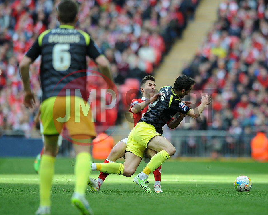Bristol City's Joe Bryan fouls Walsall's Ben Purkiss - Photo mandatory by-line: Dougie Allward/JMP - Mobile: 07966 386802 - 22/03/2015 - SPORT - Football - London - Wembley Stadium - Bristol City v Walsall - Johnstone Paint Trophy Final