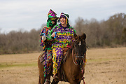 Costumed revelers on horseback during the Mamou Courir de Mardi Gras chicken run on Fat Tuesday February 17, 2015 in Mamou, Louisiana. The traditional Cajun Mardi Gras involves costumed revelers competing to catch a live chicken as they move from house to house throughout the rural community.