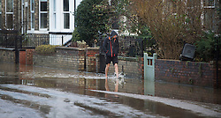 © Licensed to London News Pictures. 29/12/2015. York, UK.  A man walks through floodwater in Huntingdon Road in York on December 29, 2015. Further rainfall is expected over coming days as Storm Frank approaches the east coast of the country. Photo credit: Ben Cawthra/LNP