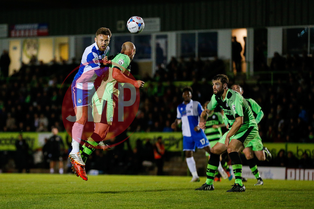 Matt Taylor of Bristol Rovers heads as David Pipe of Forest Green Rovers challenges - Photo mandatory by-line: Rogan Thomson/JMP - 07966 386802 - 29/04/2015 - SPORT - FOOTBALL - Nailsworth, England - The New Lawn - Forest Green Rovers v Bristol Rovers - Vanarama Conference Premier - Playoff Semi Final 1st Leg.