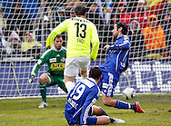 FC Basel forward Alexander (Alex) Frei (C) scores to the score of 0-1 against FC Luzern goalkeeper David Zibung (L), Elsad Zverotic (front)  and Tomislav Piljic (R) during the AXPO Super League (National League A) soccer match between FC Luzern (FCL) and FC Basel (FCB) at the Gersag stadium in Emmenbruecke, Switzerland, Sunday, February 27, 2011. (Photo by Patrick B. Kraemer / MAGICPBK)